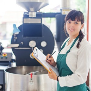 Woman checking quality of coffee